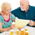 Senior couple go over their medical and prescription drug bills.