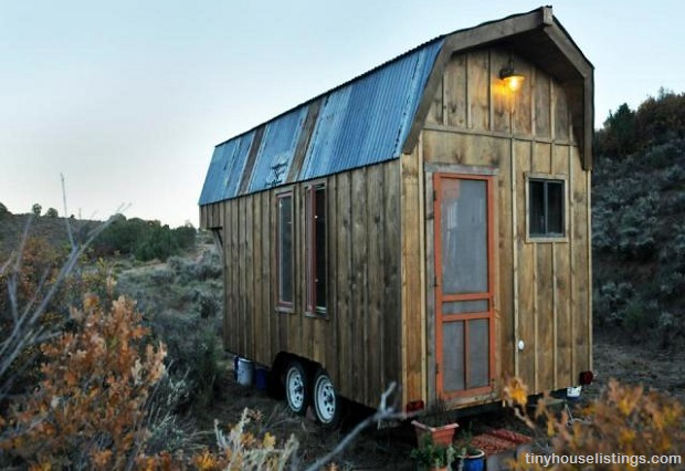 small rustic cabin on wheels