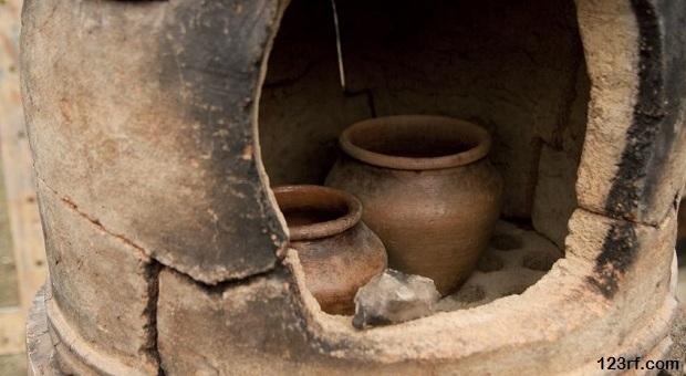 12569057 - old pottery kiln and pot. pottery theme