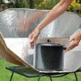 14519704 - solar cooking oven with black pot.